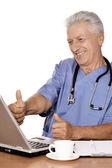 Elderly doctor with  laptop — Fotografia Stock