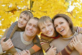 Family relaxing in autumn park — Stock Photo
