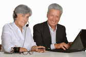 Elderly people working with laptop — Stock Photo