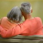 Elderly couple resting at autumn park — Stock Photo #73670647