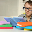 Boy does homework at home — Stock Photo #73670875