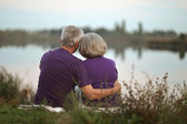 Mature couple  near lake — Stock Photo