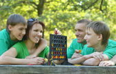 Family resting in  summer park — Stock Photo