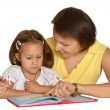 Mother doing homework with  daughter — ストック写真 #74096869