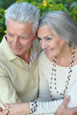 Mature couple in summer park — Stock Photo
