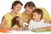 Parents help children with homework — Stock Photo