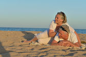 Mature couple relaxing on beach — Stock Photo