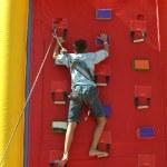 Little boy at climbing wall — Stock Photo #75027915