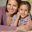 Mother doing homework with  daughter — ストック写真 #76421409