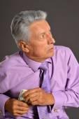 Elderly man portrait  with dollars — Stock Photo