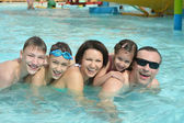 Family having fun in pool — Stock Photo