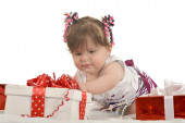Cute baby girl  with gifts — Stock Photo