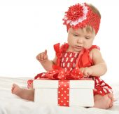 BAby girl in   dress  with gift — Stock Photo