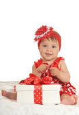 BAby girl in   dress  with gift — Stock fotografie