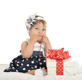 Cute baby girl with gift — Stock Photo