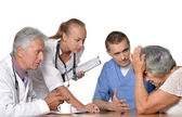 Old woman visitting  doctors — Stock Photo