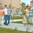 Family relaxing at resort — Stock Photo #80702100
