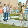 Family relaxing at resort — Stock Photo #80702726