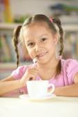 Cute little girl with cup — Stock Photo