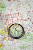 Compass On Map Pointing North — Stock Photo