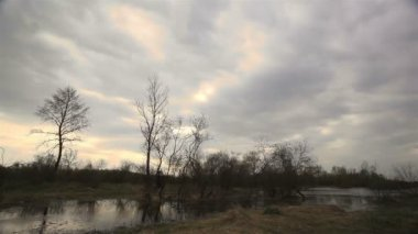 Cloudy weather with the small river. Time lapse — Stock Video