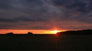 Gloomy clouds at sunset in the steppe.  NTSC  Timelapse — Stock Video