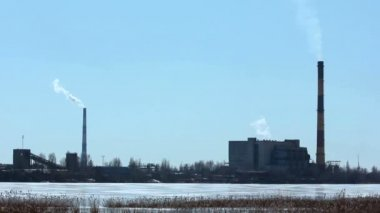 The frozen lake and the building with a chimney — Stockvideo