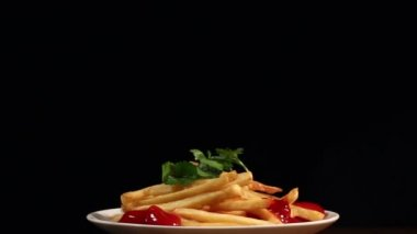 Fried French fries with ketchup and salad — Stock Video
