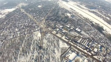 City suburb with trees. Bird's  winter aerial  view — Stock Video