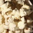 White glass with popcorn rotates close up. Top view — Stock Video #63153781