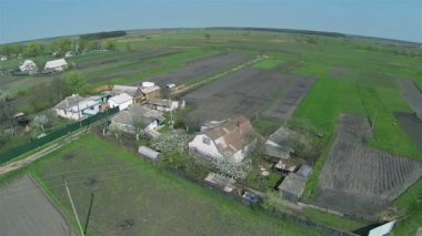 Usual Ukrainian village with green fields. Aerial — Stockvideo