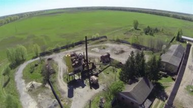 Old pipe on sawmill , Camera inclination down .Aerial — Stock Video