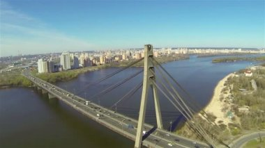 Bridge with cars over  river in  city. Aerial — Stock Video