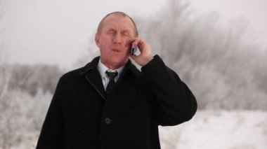 Businessman receives good news and shows  finger up. Winter — Stock Video