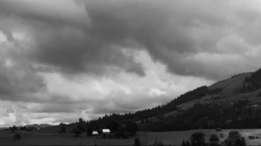Beauty of nature. Clouds in mountains. Time lapse in black and white — Stock Video