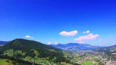 Mountain settlement and beautiful sky with clouds. Time lapse — Stock Video