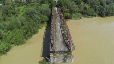 Destroyed bridge through river .Aerial shot Camera inclination — Stock Video