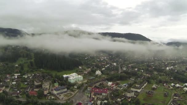 Flight among clouds over mountain village. Aerial — Vidéo