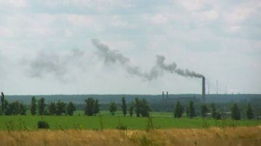 Industrial pipes with  smoke and fields. Landscape, — Stock Video