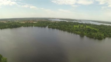 Slow Flight over park and  river in suburbs. Aerial — Stock Video