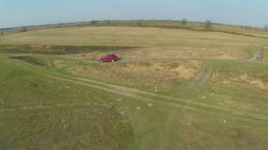 Car goes on  country road. Aerial — Stockvideo