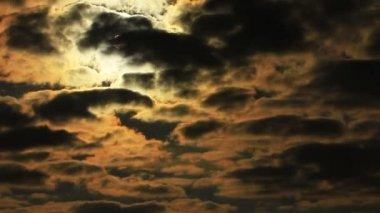 Drama sun through  orange  dark clouds in sky. Time lapse in red tones — Stock Video