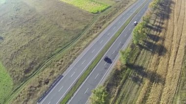Flight over  highway with cars in sunny day  Aerial top view — Stock Video