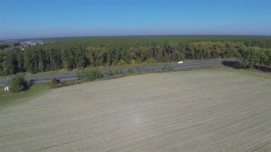 Agricultural field and the road with cars. Aerial — Stock Video
