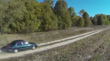 Lonely  green car on  rural dirt road . Aerial  view — Stock Video