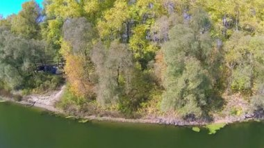 Autumn landscape with  river and tents in  wood. Aerial  shot — Stock Video