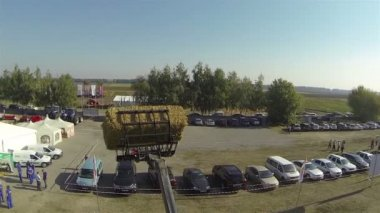 Haystack  on  farm vehicle. Aerial — ストックビデオ