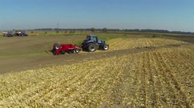 Modern new tractor in  field. Aerial — Stock Video