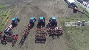 Modern new tractors  . Aerial  top view with descent — Stock Video