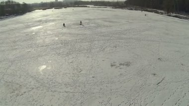 Fisherman on  winter frozen lake. Aerial — Stock Video